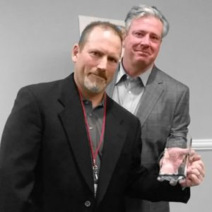 Tom Allen receives his award from ABBRA President, Ron Helbig